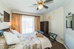 TWO-BEDROOM APARTMENT: Main bedroom with Queen bed