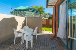 TWO-BEDROOM APARTMENT: Outside patio with BBQ facilities