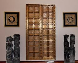 Indian Castle Door with primitive iron wood grave sculptures