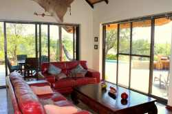 Spacious living room with sliding doors to the terrace. Ultimate indoor / outdoor living. Uninterupted views of the bush.