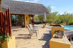 A stone BBQ next to the pool with a view of the bush and the Kruger park on the horizon.