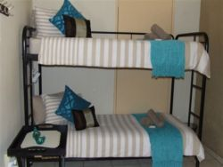 A bunkbed (2 single beds) in a private corner of the open-plan area.