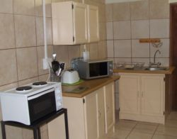 The fully equipped kitchen has a microwave, mini stove / oven;  toaster, kettle, large fridge and all other necessary crockery and cutlery.