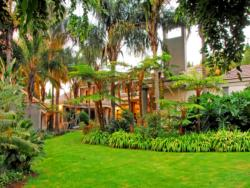 The lush gardens create a tranquil and peaceful setting