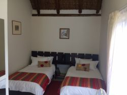 Stoor:  Room room with 2 single beds ensuite which can be converted into a Kingsize bed: R600 per night