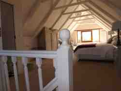 view of loft room showing a glimpse of slipper bath