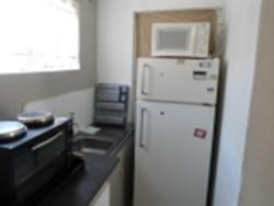 Fully equipped with 2 plate stove with oven,Microwave,toaster,2 door fridge.