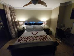 Special night out with rose petals in Superior room.
