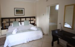 Dolphin luxury bedroom with king size or twin beds. Additional bed optional. Covered patio