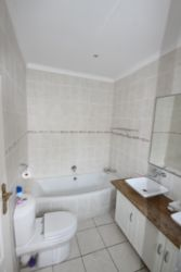Whale en-suite bathroom with double wash hand basins, bath and separate shower