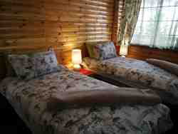 Oriole & Sunbird chalet bedroom (optional 2 singles or a King)