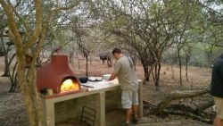 Making Pizzas in the bush at the Boma area